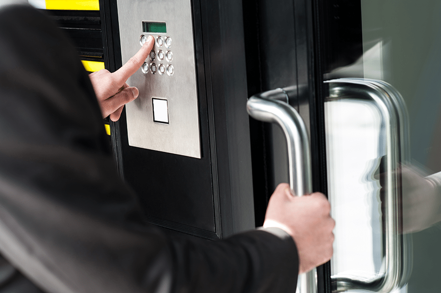 bigstock-Man-Entering-Security-Code-To--51551620